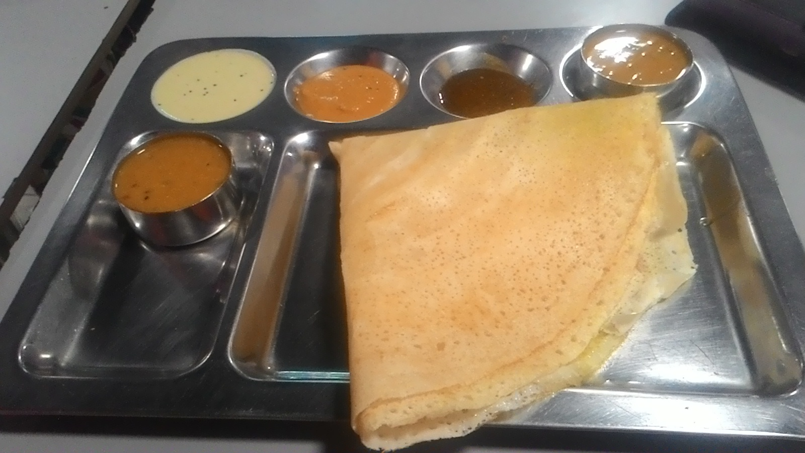 Dosa Ghee Roast Served with Sambhar - Kerala Dishes to Try When In Kerala